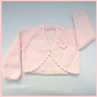 Pale pink hand knitted baby bolero cardigan 3 to 6 months.