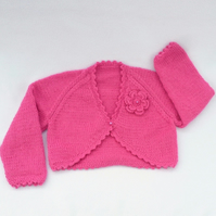 Raspberry pink hand knitted baby bolero cardigan 6-12 months.