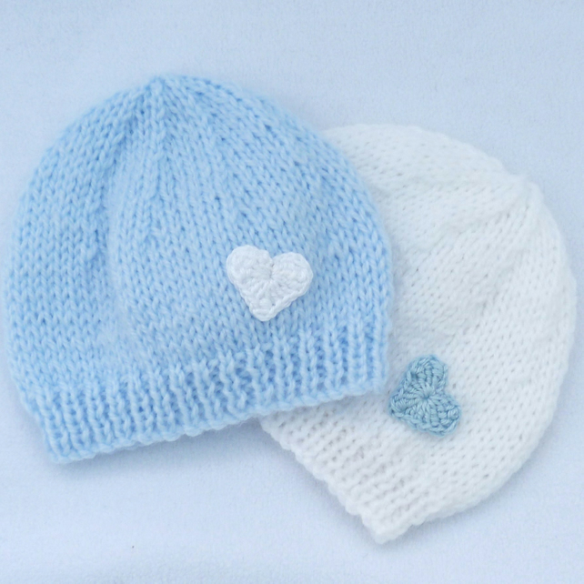 Set of 2 hand knitted premature baby  beanie hats in pale blue and white.