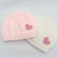 Set of 2 hand knitted premature baby  beanie hats in pale pink and white.