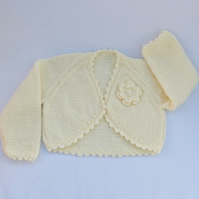 Baby bolero hand knitted in cream to fit 6 to 12 months
