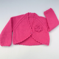 Raspberry pink hand knitted baby bolero cardigan 3 to 6 months.