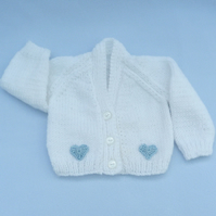 Hand knitted premature baby cardigan in white.