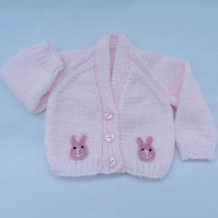 Hand knitted pale pink premature baby cardigan.