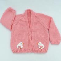 Salmon pink hand knitted baby cardigan 3 to 6 months