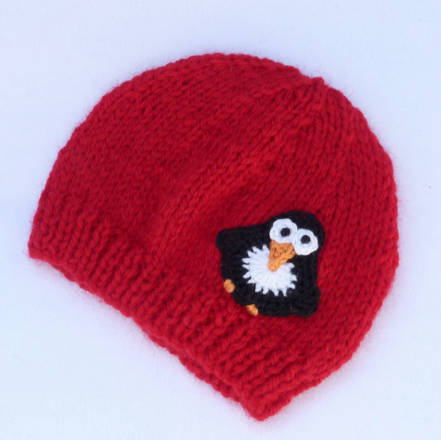 Hand knitted red premature baby Christmas beanie hat.