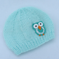 Hand knitted  pale turquoise baby beanie hat to fit a 0 to 3 months baby.
