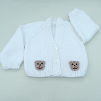 Hand knitted white baby cardigan to fit a 0 to 3 monthsbaby.