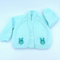 Hand knitted premature baby cardigan in pale turquoise to fit tiny baby.