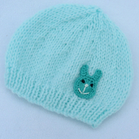 Hand knitted premature baby beanie hat in pale turquoise to fit a tiny baby.