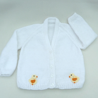 Hand knitted white baby cardigan to fit a 12 to 18 months baby.