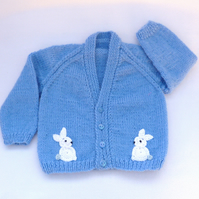 Hand knitted dark blue baby cardigan to fit a  6 to 9 months baby.