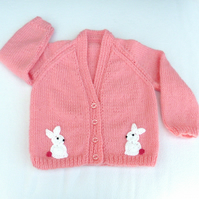 Hand knitted sugar pink baby cardigan to fit a  6 to 12 months baby.