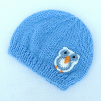 Hand knitted  dark blue baby beanie hat to fit a 0 to 3 months baby.