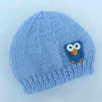 Hand knitted premature baby  beanie hat in sky  blue.
