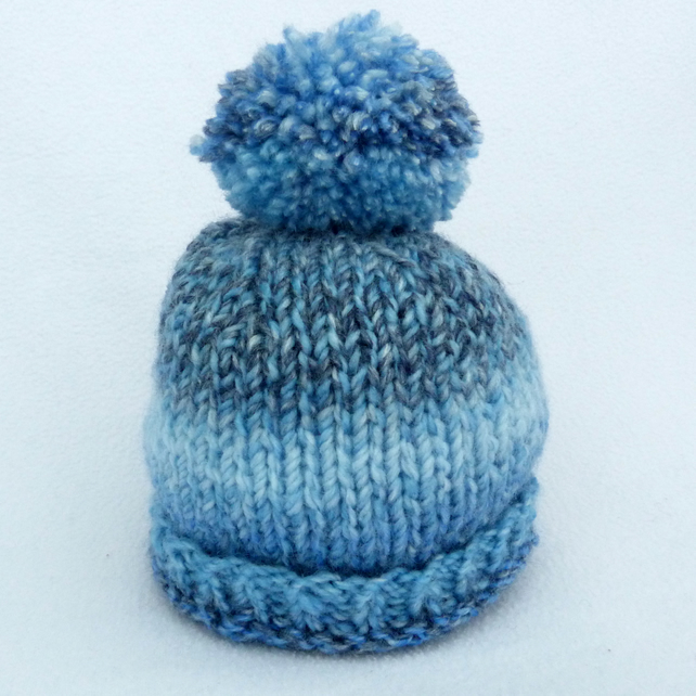 Baby beanie bobble  hat hand knitted in variegated blue to fit 0 to 3 months