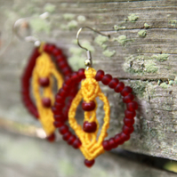 Macrame earrings with beads in yellow and red