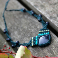 Choker with blue sun stone and glass beads