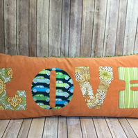 Vintage fabric 'LOVE' bolster cushion with appliqué