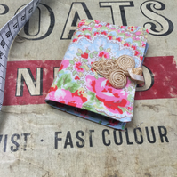 Small floral print needle book