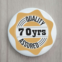 70th birthday pin badge quality assured 58 mm