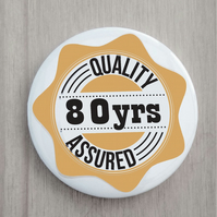 80th birthday badge quality assured 58 mm