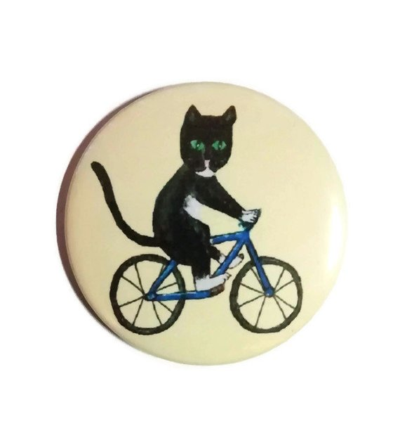 Cat on a bike pocket mirror