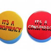 It's a conspiracy pin badge 45mm