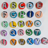 Letters of the alphabet pin badges buttons