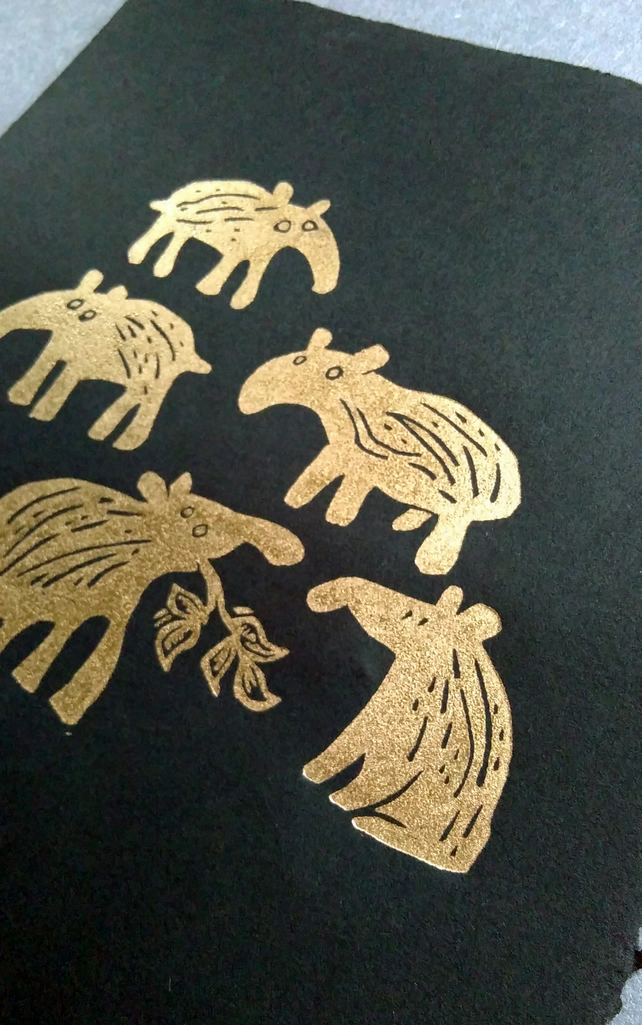 Five Gold Baby Tapirs - lino cut print