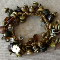 Quirky, unusual elasticated beaded bracelet in shades of brown and gold