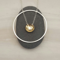 Silver circle & brass necklace, silver pendant, minimalist jewellery