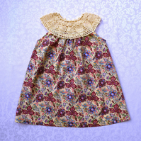 Exquisite yellow paisley baby dress with fine crochet yoke. Approx 1-2 years