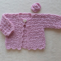 Baby girl lace jacket in fine alpaca with rose  hair grip. 0-6 months