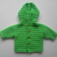 Bright green hooded baby coat in merino wool with frog buttons. 0-6 months