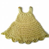 Soft cotton lace baby sun dress in lemon yellow. 0-9 months