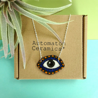Eye pendant necklace with a south American influenced pattern