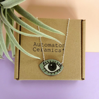 Eye with lashes pendant necklace in grey