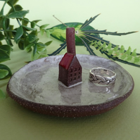 Little factory ring dish made from dark terracotta with a white and red glaze.