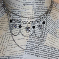 Silver Face Charm Multi Chain Statement Necklace
