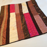 multi coloured silk quilted throw inspired by kanthas