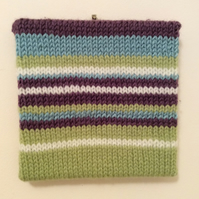 knitted striped abstract art in purple green blue and white wool