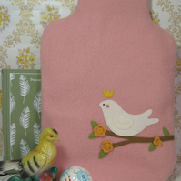 Vintage pink wool hot water bottle cosy