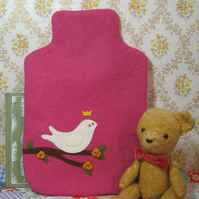 Raspberry coloured vintage wool hot water bottle cosy