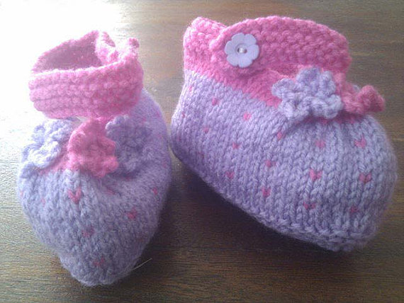 Pink and purple knitted baby booties