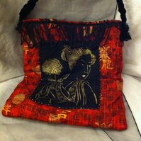 Red Geisha patterned print shoulder bag