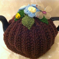 Floral crocheted tea pot cosy