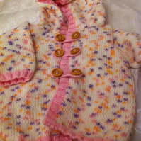 Pink spotted knitted hooded baby cardigan