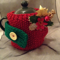 Festive knitted small teapot cosy