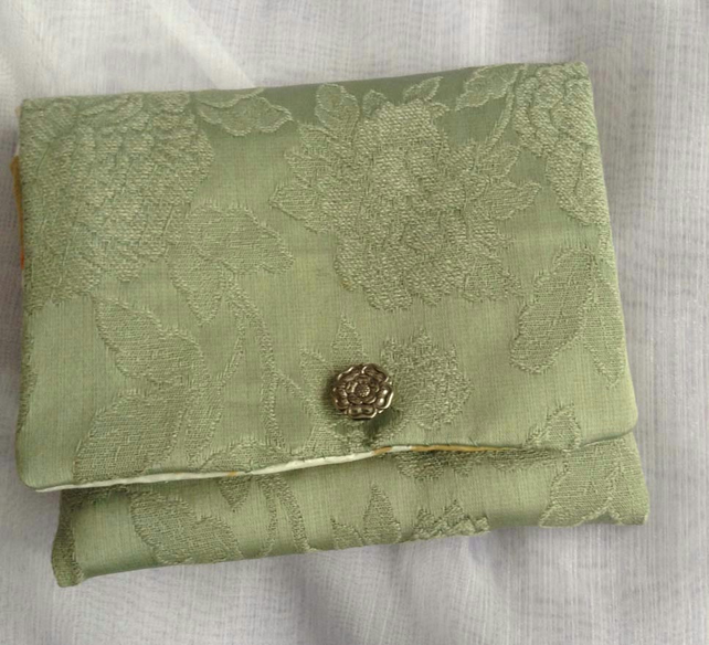 Green floral cotton clutch